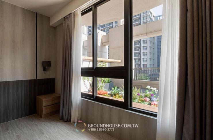 室內往外望出 大地工房景觀公司 Tropical style balcony, veranda & terrace