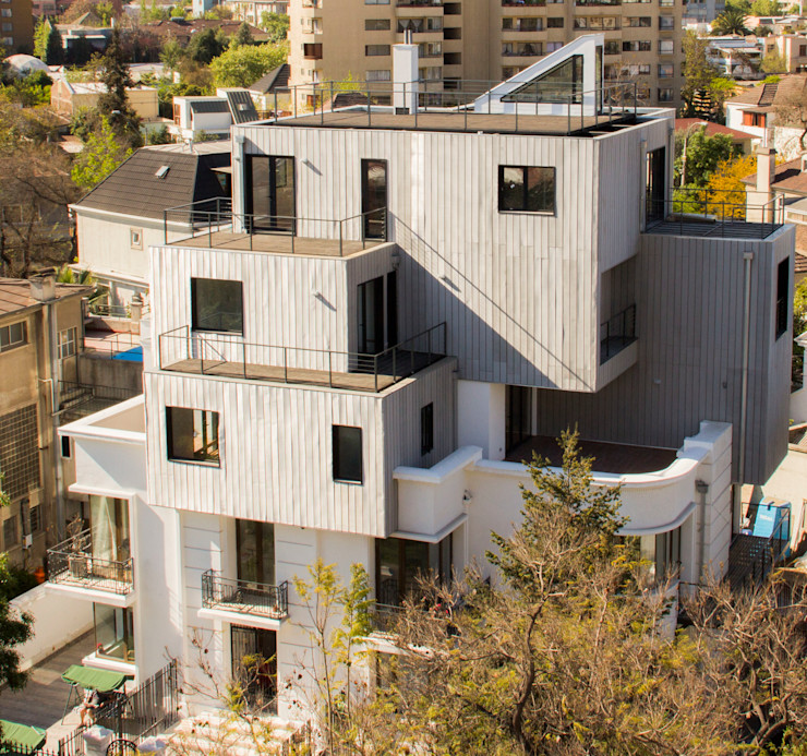 Edificio con Fachada transventilada INFINISKI Casas estilo moderno: ideas, arquitectura e imágenes
