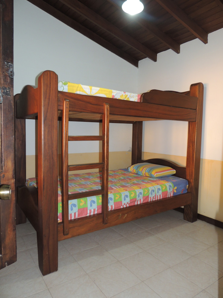 CIENTO ONCE INMOBILIARIA Rustikale Schlafzimmer