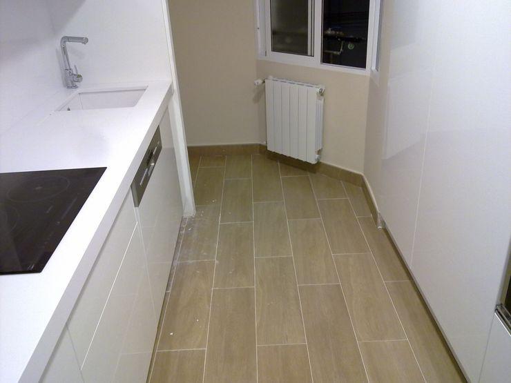 Obrisa Reformas y rehabilitaciones. Built-in kitchens Wood White