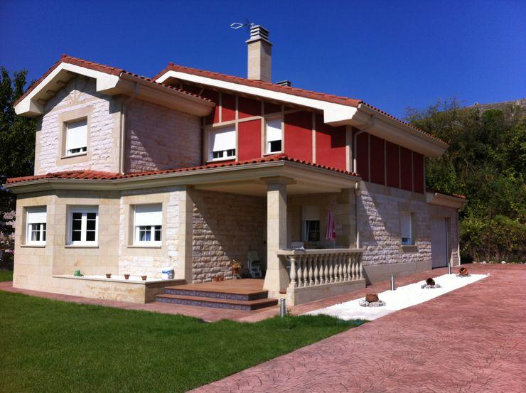 Vista general riarsa 2006 constructores en burgos Casas de estilo rústico Arenisca Rojo