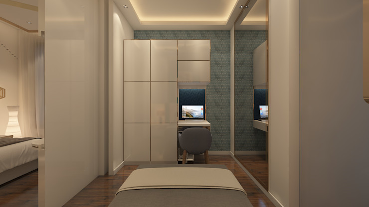 The wadrobe and study table. Sagar Shah Architects Small bedroom Wood White