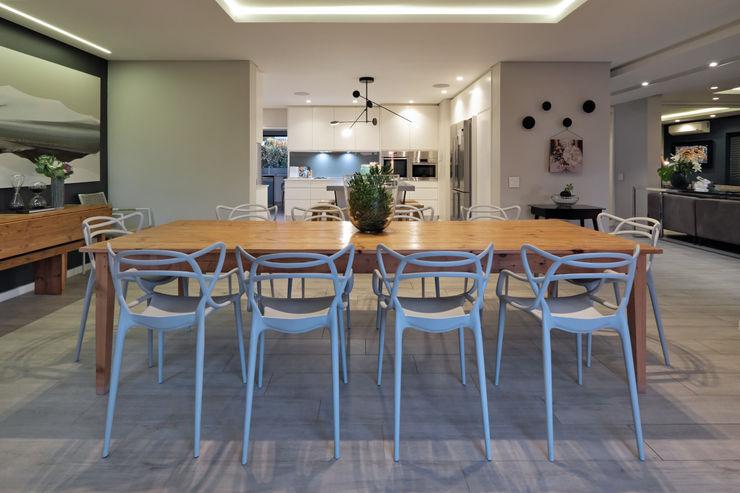 KMMA architects Salas de jantar modernas