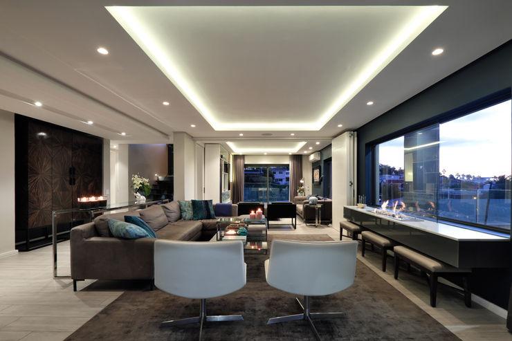 KMMA architects Salas de estar modernas