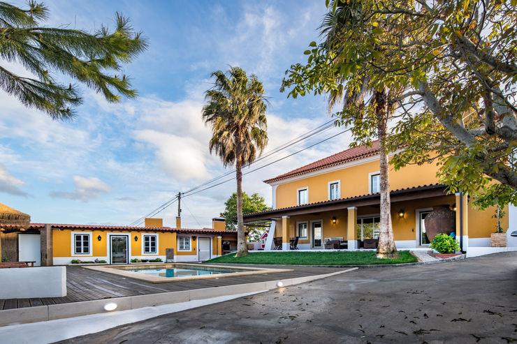 Atelier d'Maison Casas familiares Amarelo