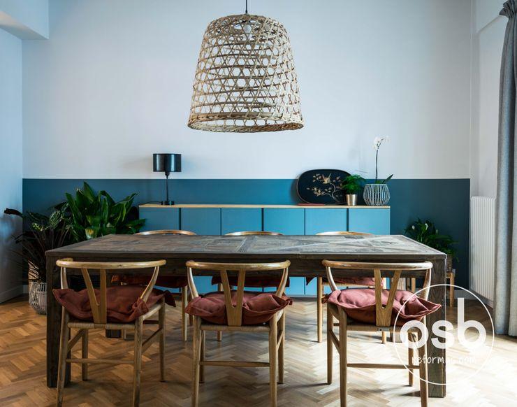 vista del comedor abierto osb arquitectos Comedores de estilo rústico Acabado en madera