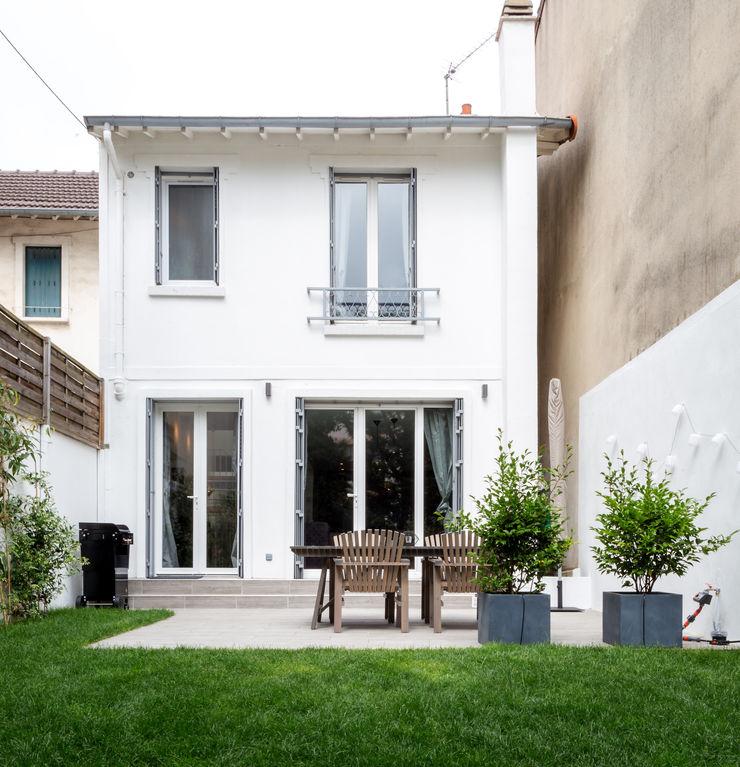 Vue de la façade arrière et du jardin Créateurs d'Interieur Maison individuelle