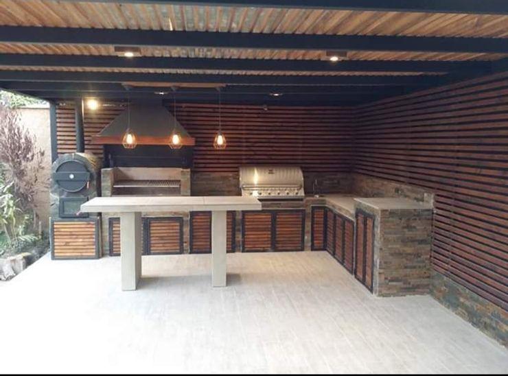 Construcción de Quinchos N&V diseño y construcción Balcones y terrazas modernos