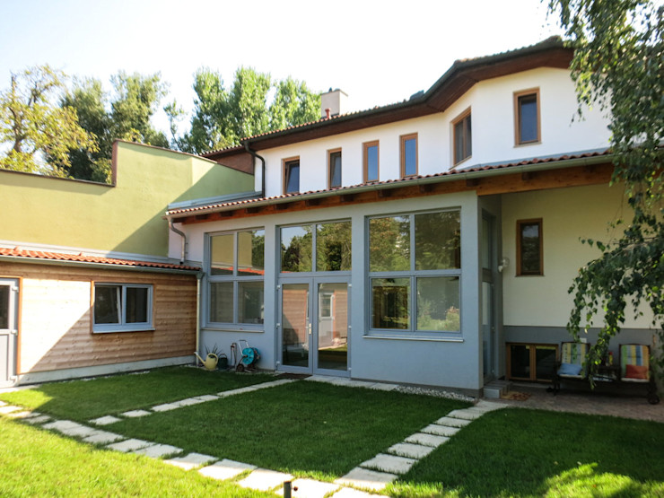 Sommergarten archipur Architekten aus Wien Moderner Wintergarten Ziegel Grau