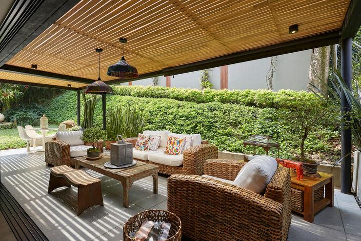 Casa Avellaneda CAJA BLANCA Balcones y terrazas de estilo rústico