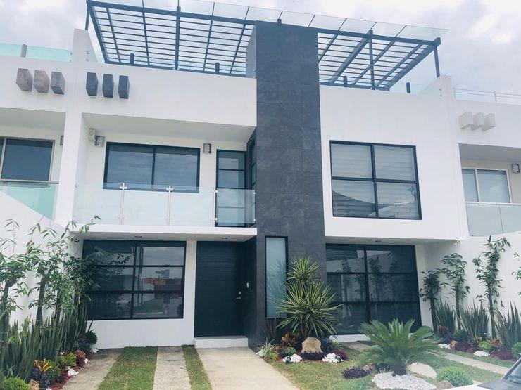 Casa con sistema inteligente de domótica Navecsa Constructora Casas de estilo minimalista