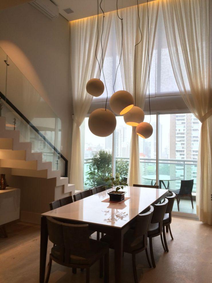Elaine Hormann Architecture Sala de jantarIluminação Alumínio/Zinco Bege