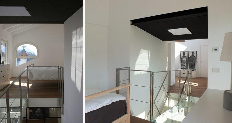 CAMERA MASTER MOLTENI / BARON ASSOCIATI Camera da letto moderna Bianco