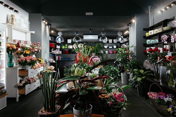 Il negozio manuarino architettura design comunicazione Negozi & Locali commerciali in stile minimalista Legno Grigio