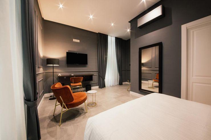 Camera bed and breakfast con poltrona e zona giorno Meka Arredamenti Camera da letto moderna Ambra/Oro