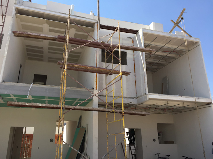 OBRA Arqcubo Arquitectos Casas prefabricadas Concreto Blanco