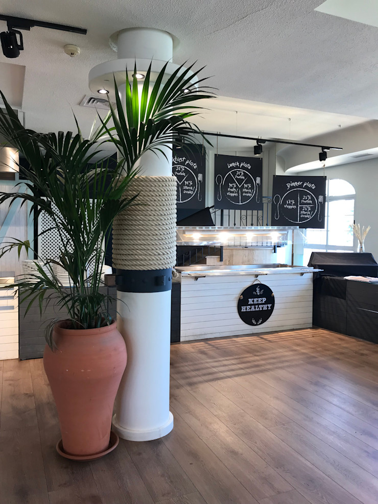 Decoración en buffet A interiorismo by Maria Andes Gastronomía de estilo mediterráneo Madera Blanco