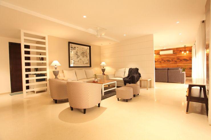 Saloni Narayankar Interiors Salas de estar modernas de madeira e plástico Branco