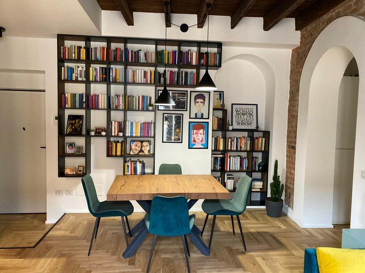 Zona Living/Pranzo Giorgio Gravina Sala da pranzo in stile industriale