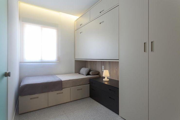 Segundo dormitorio con dos camas MANUEL GARCÍA ASOCIADOS Dormitorios de estilo moderno