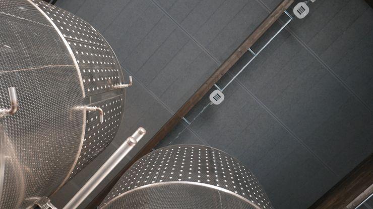 Copertura Next Panel Imola Legno S.p.A. socio unico Spazi commerciali in stile industrial Legno
