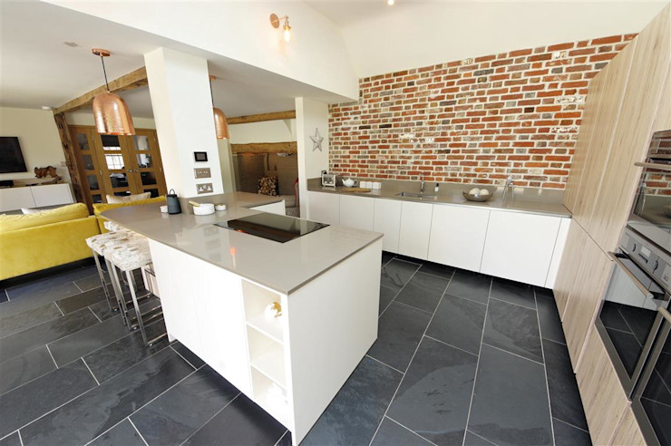 Modern kitchen with Brick wall feature PTC Kitchens Modern kitchen Wood effect