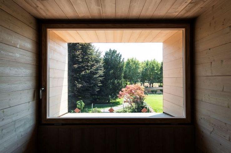 Casa nel parco Fluido Arch - Studio di Architettura Studio moderno Legno Effetto legno
