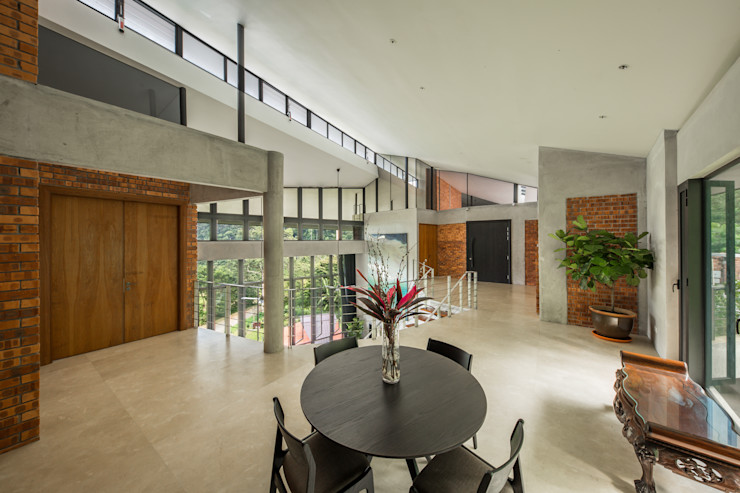 Upstairs pantry space overlooking the atrium MJ Kanny Architect Tropical style living room