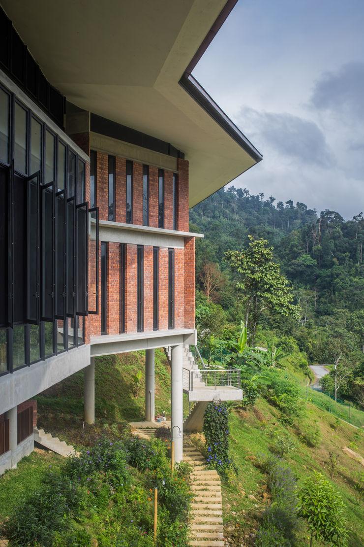 Rear Facade MJ Kanny Architect Tropical style houses