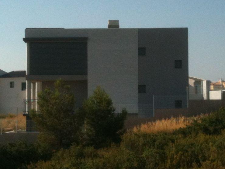 Vista exterior Noreste OCTANS AECO Casas de estilo moderno