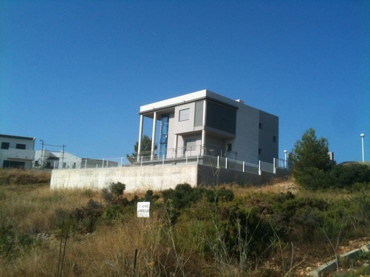 Vista exterior sureste OCTANS AECO Casas de estilo moderno