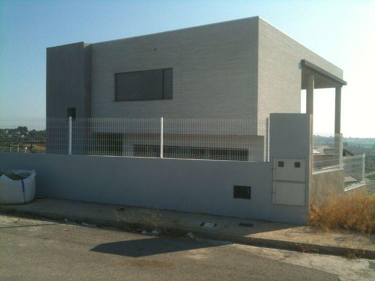 Vista exterior noroeste OCTANS AECO Casas de estilo moderno