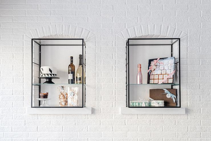 Vetrine manuarino architettura design comunicazione Negozi & Locali commerciali in stile minimalista Pietra Bianco