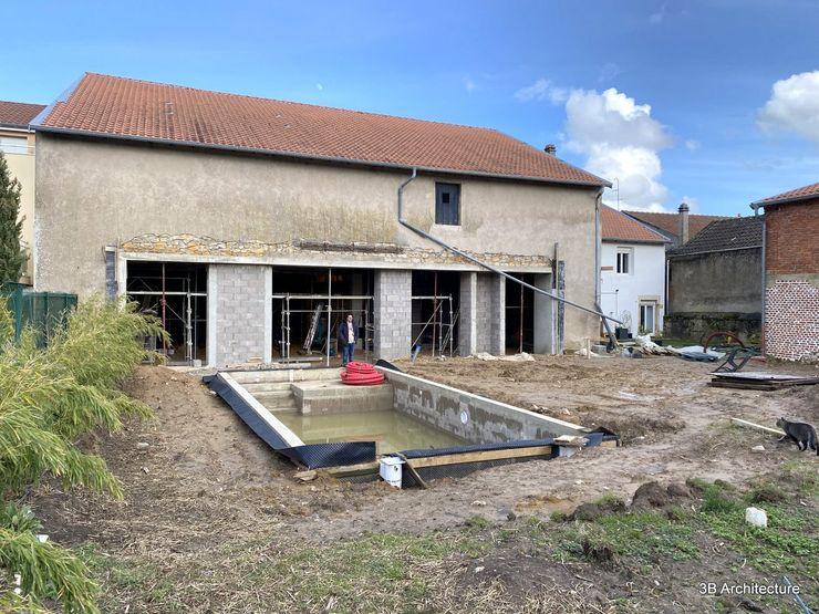 Travaux - Réalisation des nouvelles baies et de la piscine 3B Architecture Maisons de campagne