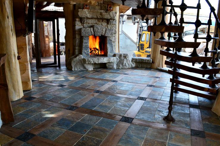 Камин из камня Big House Гостиная в рустикальном стиле Камень