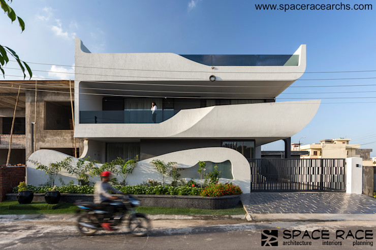 FRONT ELEVATION SPACE RACE ARCHITECTS Minimalist houses