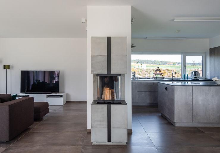 Wohnen herbertarchitekten Partnerschaft mbB Moderne Wohnzimmer Grau