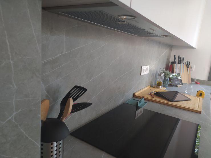 Vista interior: imagen del parte del banco de la cocina y encimera OCTANS AECO Cocinas de estilo moderno