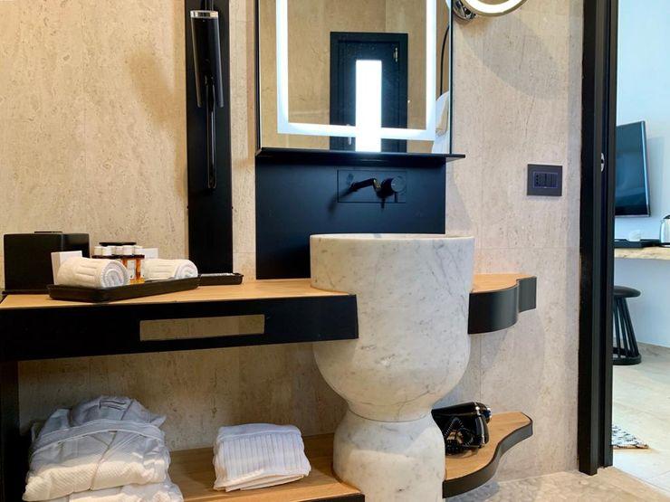 Bathroom ROMAZZINO C.S. SERVICE SRL Hotel moderni