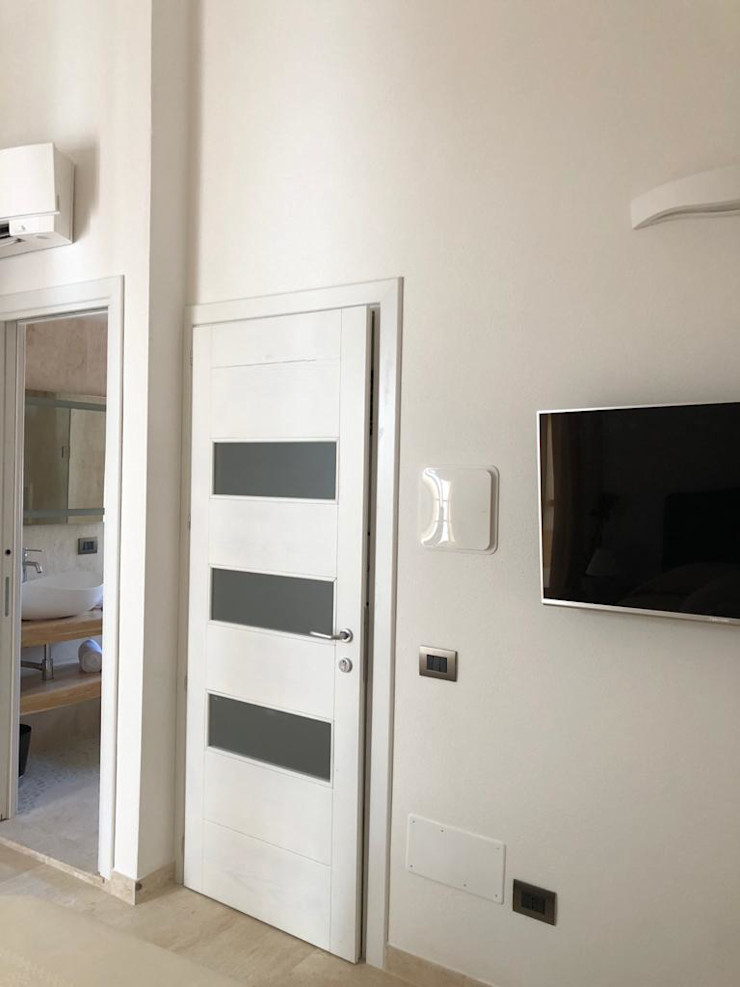 Ingresso ROMAZZINO C.S. SERVICE SRL Ingresso, Corridoio & Scale in stile moderno