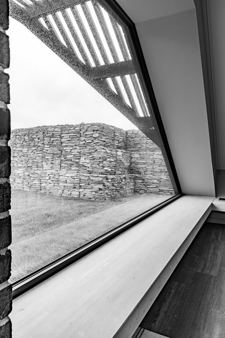 Angular Windows frame the view out of this bedroom Arco2 Architecture Ltd Modern style bedroom