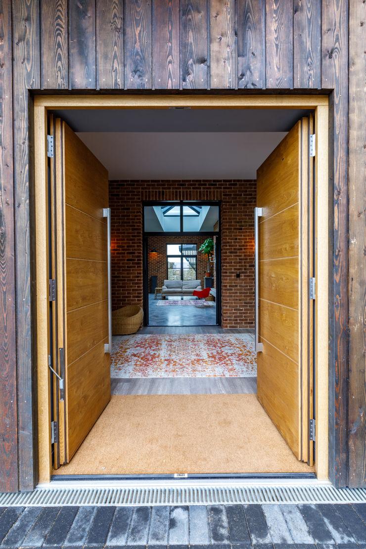 Wooden front door Arco2 Architecture Ltd Front doors