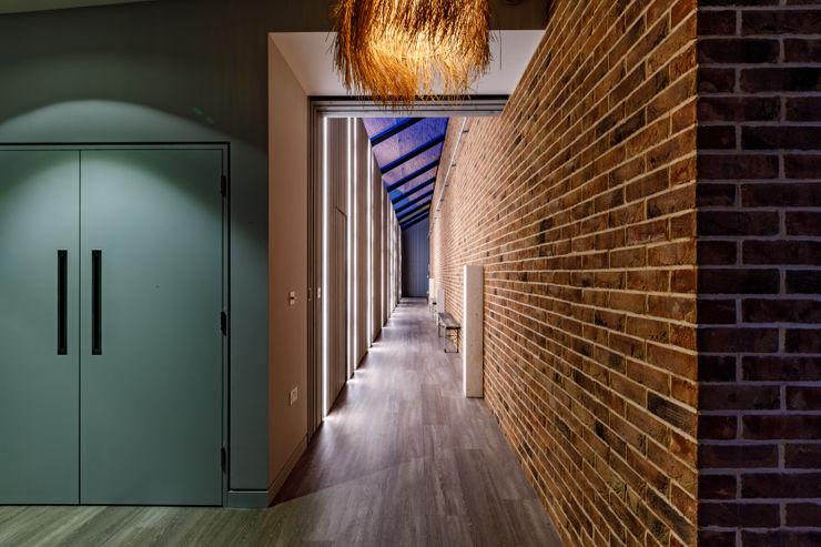 Internal corridor Arco2 Architecture Ltd Modern corridor, hallway & stairs