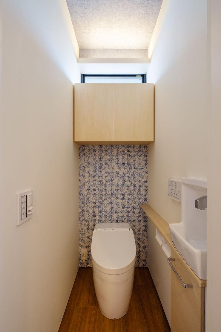 明大前の賃貸併用二世帯住宅 設計事務所アーキプレイス 洗面所&風呂&トイレ収納 合板(ベニヤ板) 木目調
