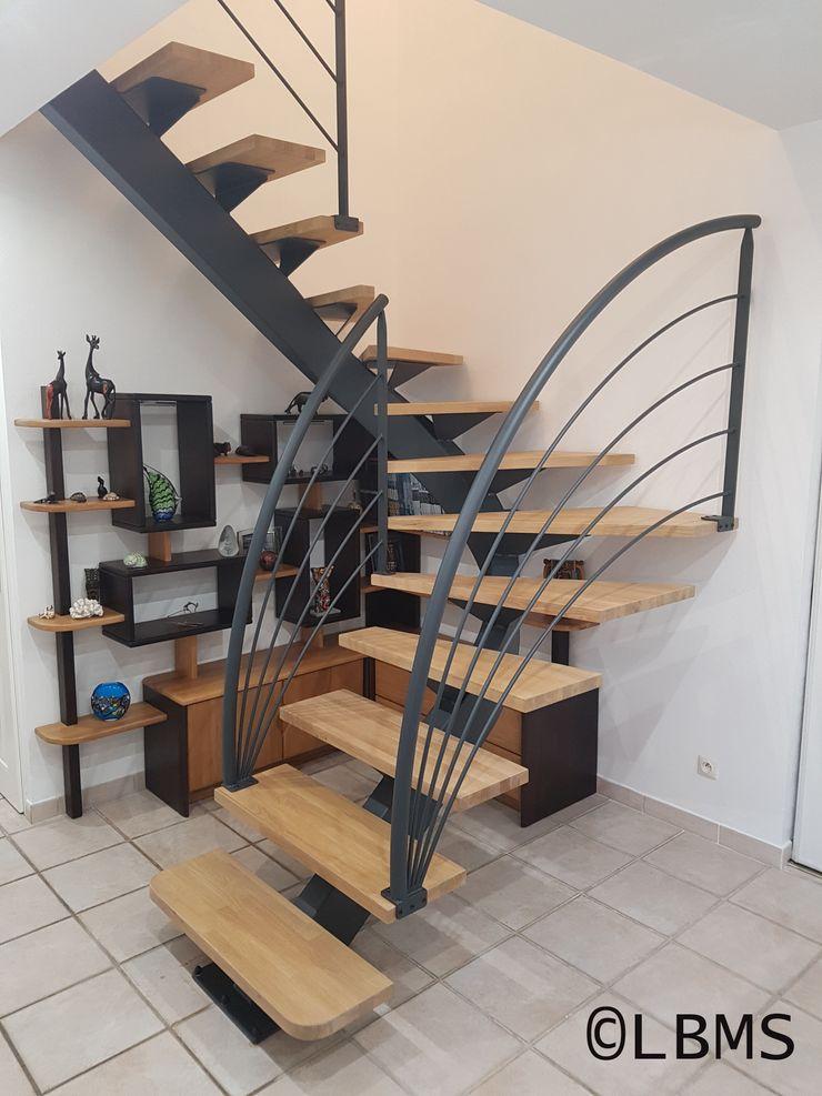 Escalier métallique limon central débillardé. LBMS. Fabrice Lamouille Escalier Métal