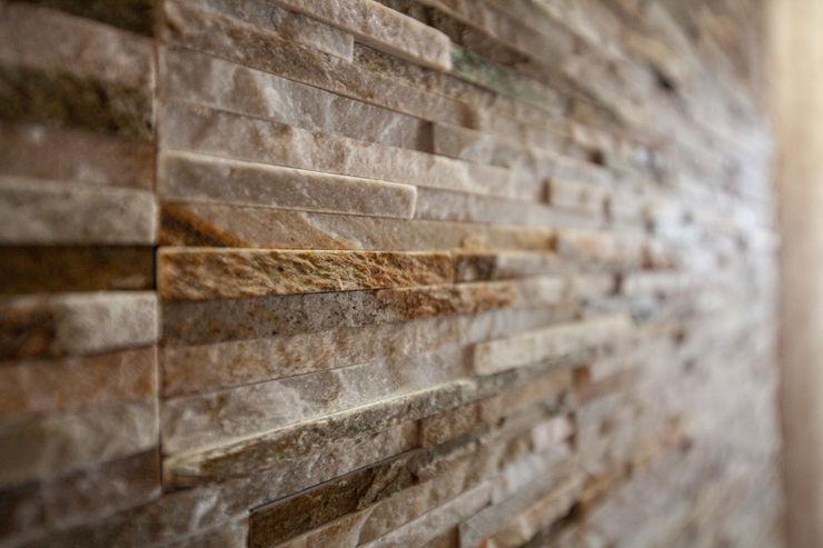 antonio felicetti architettura & interior design Ruang Makan Klasik Batu Brown