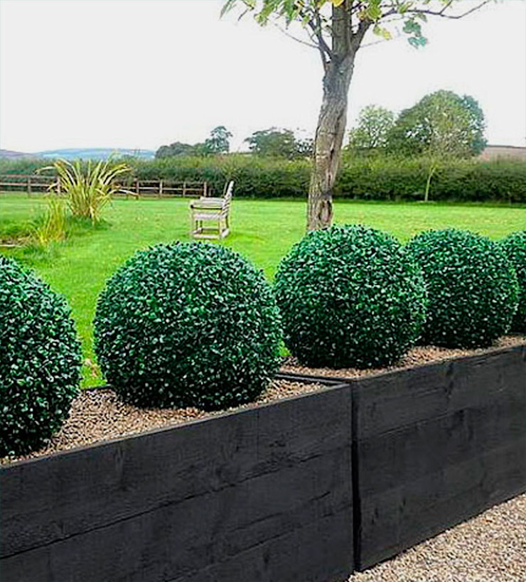 Divide Space with Outdoor Faux Topiary Ball Planters Sunwing Industries Ltd Commercial Spaces