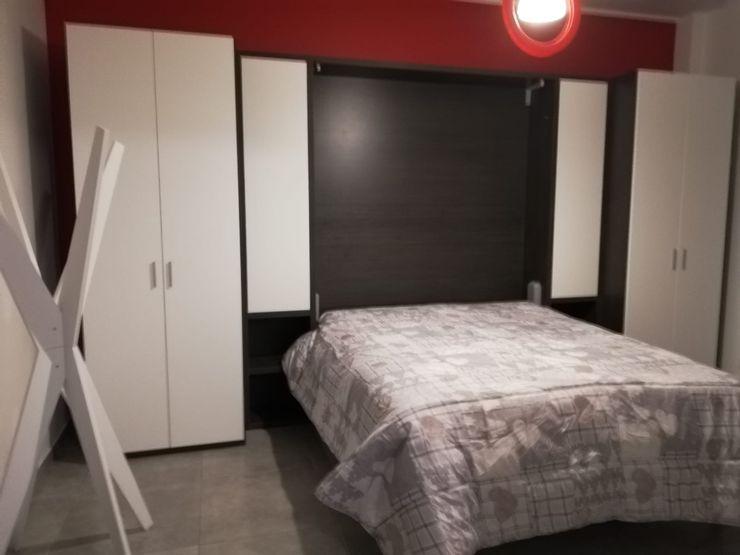 Parete trasformabile aperta Silvia Camporeale Interior Designer Studio moderno Legno composito Bianco