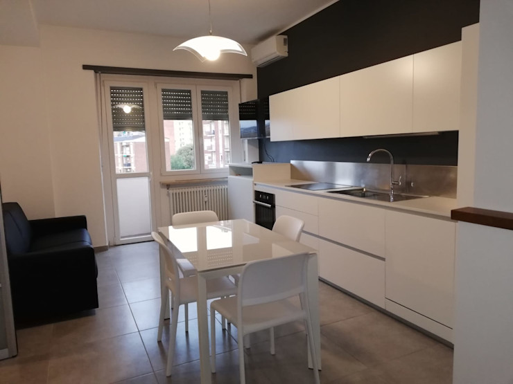 Realizzazione dell'ambiente living Silvia Camporeale Interior Designer Cucina attrezzata Ferro / Acciaio Bianco