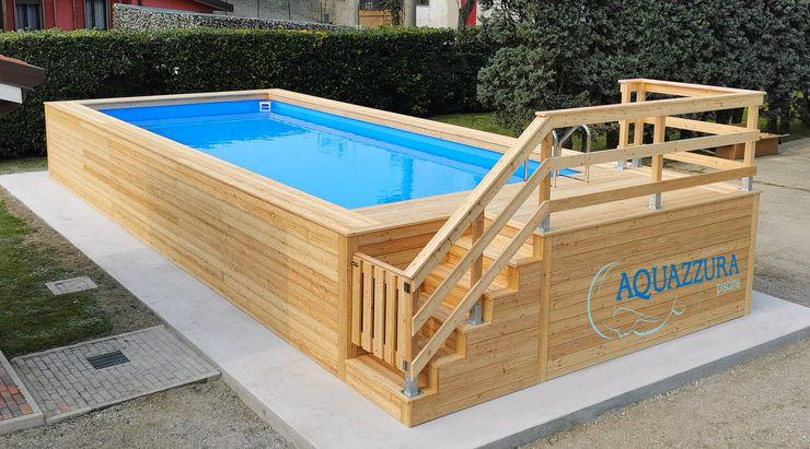 Piscina fuori terra rivestita in legno di larice siberiano, con cancelletto di sicurezza. Aquazzura Piscine Giardino con piscina